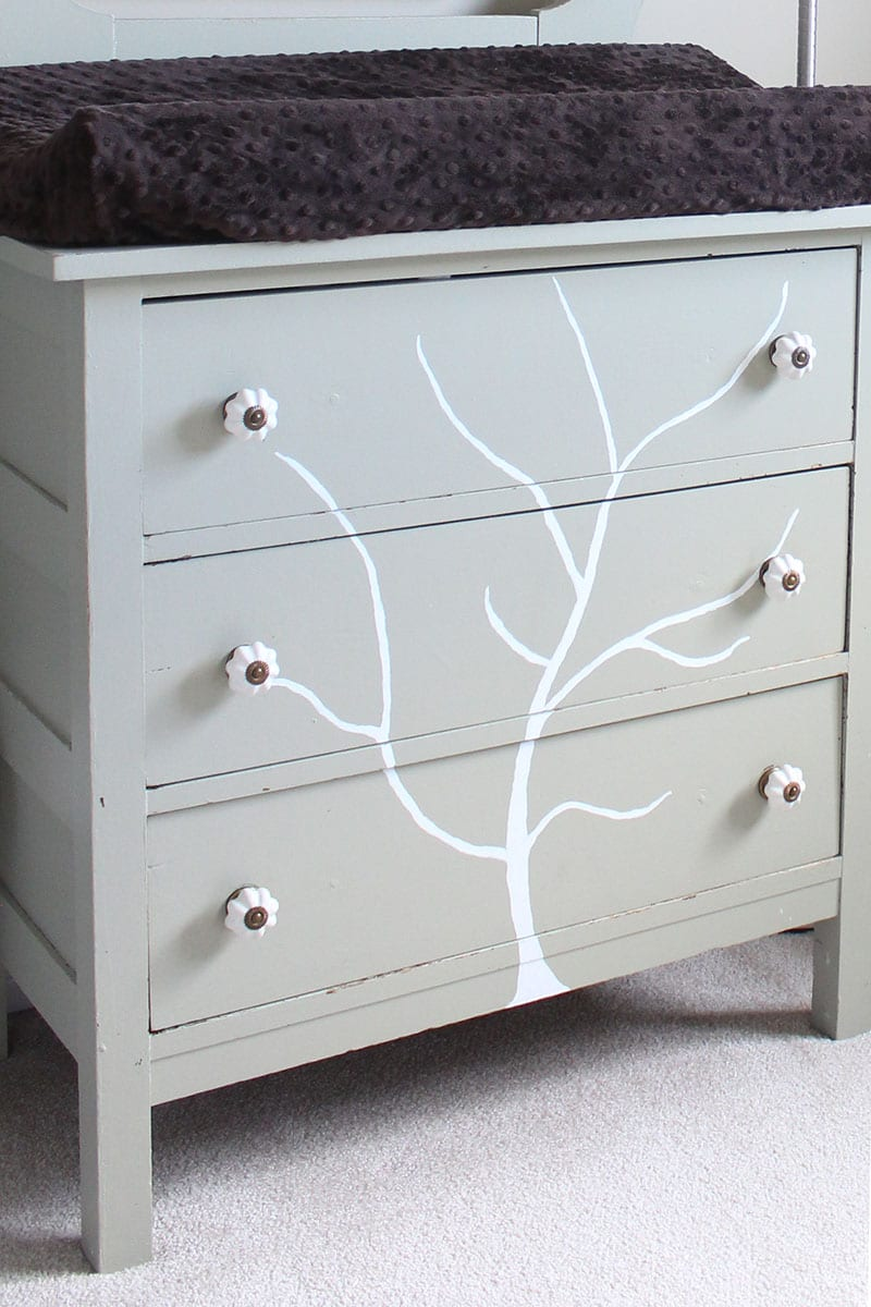 A handpainted tree dresser used as a change table.