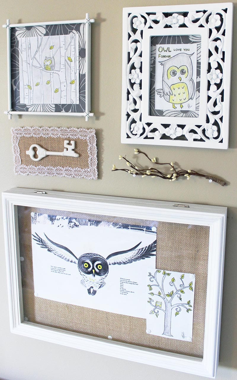 Vintage-inspired mounted key artwork as part of an owl gallery wall.