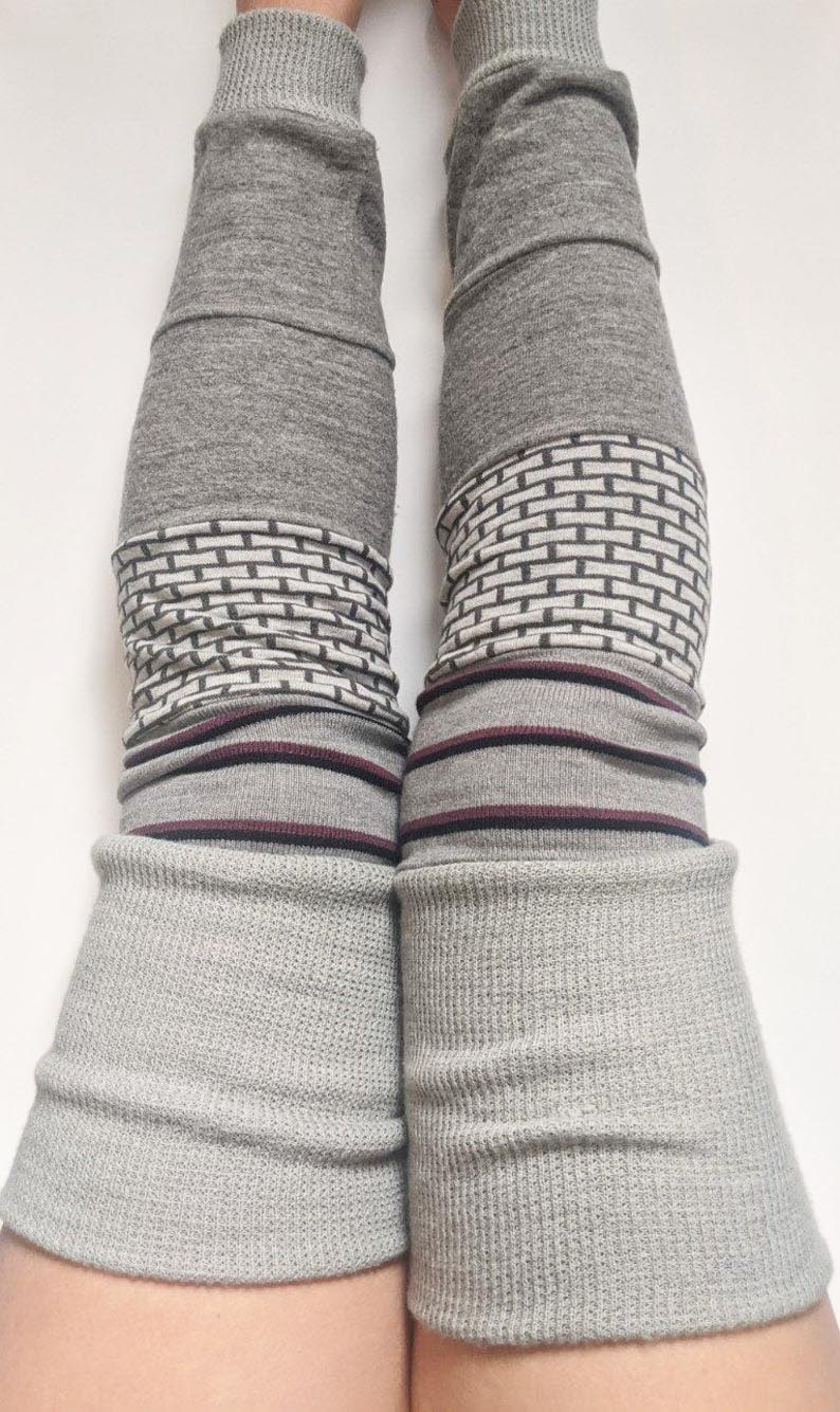 Leg warmers aren't just for dancers. They keep the legs toasty and also look kind of cute, no? Here are two ways to make DIY leg warmers out of old socks. Or, you could just buy a pair of upcycled leg warmers from Etsy!