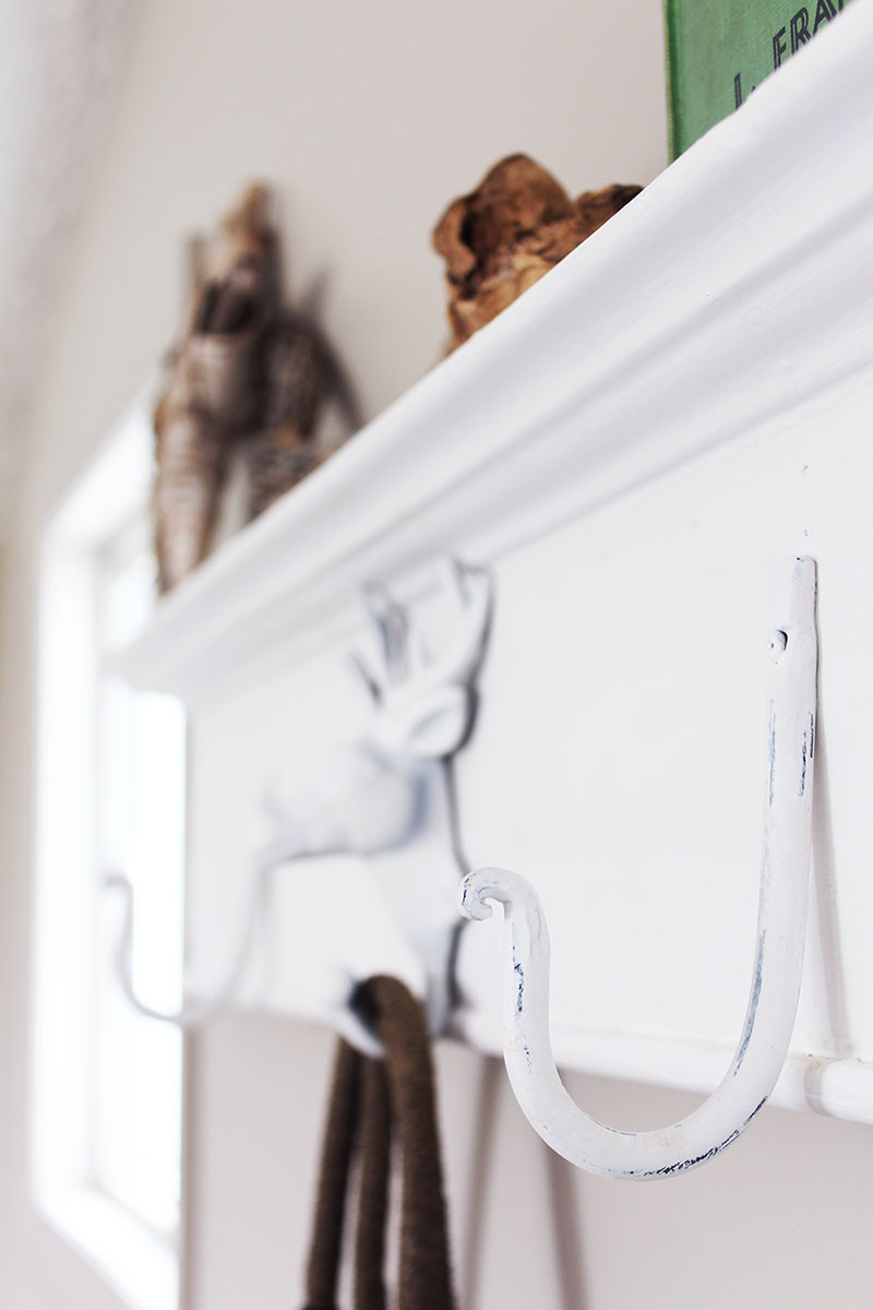 Want to create a unique place to hang your stuff? Grab an antique header, throw on some metal hooks and you've got yourself a DIY wall mounted coat rack!