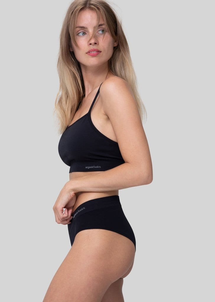 Want to create an eco-friendly laundry practice? Cut down on water use by washing your clothes less often - and invest in high-quality clothing basics. Like these anti-microbial hipster briefs and sports bra by Organic Basics.
