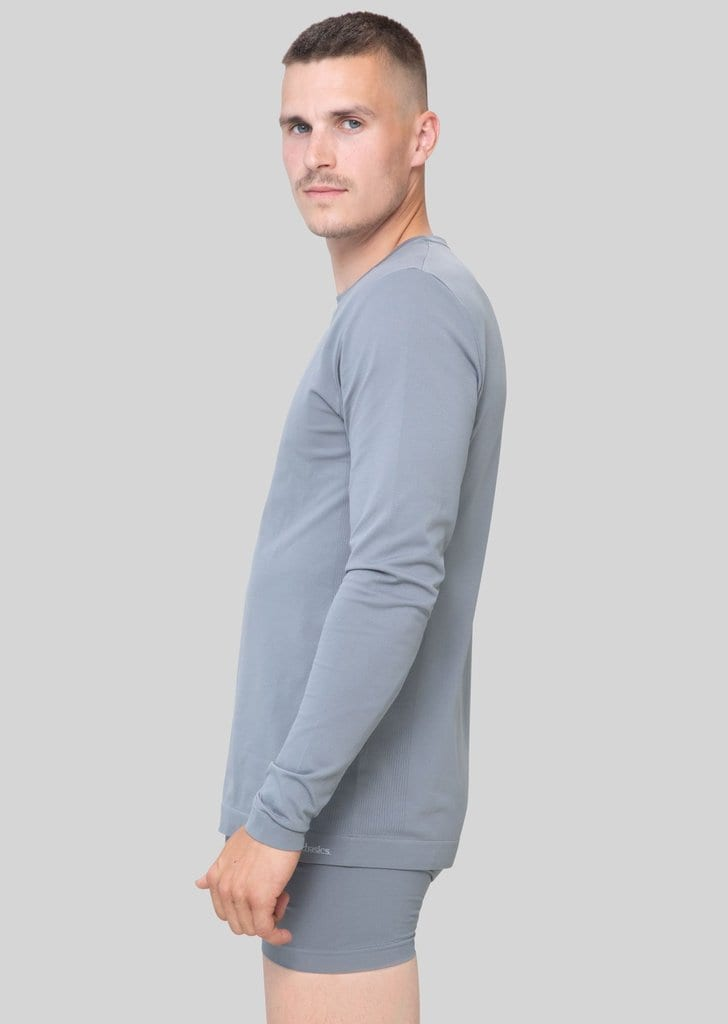 Want to create an eco-friendly laundry practice? Cut down on water use by washing your clothes less often - and invest in high-quality clothing basics. Like this anti-microbial long-sleeve and boxers by Organic Basics.