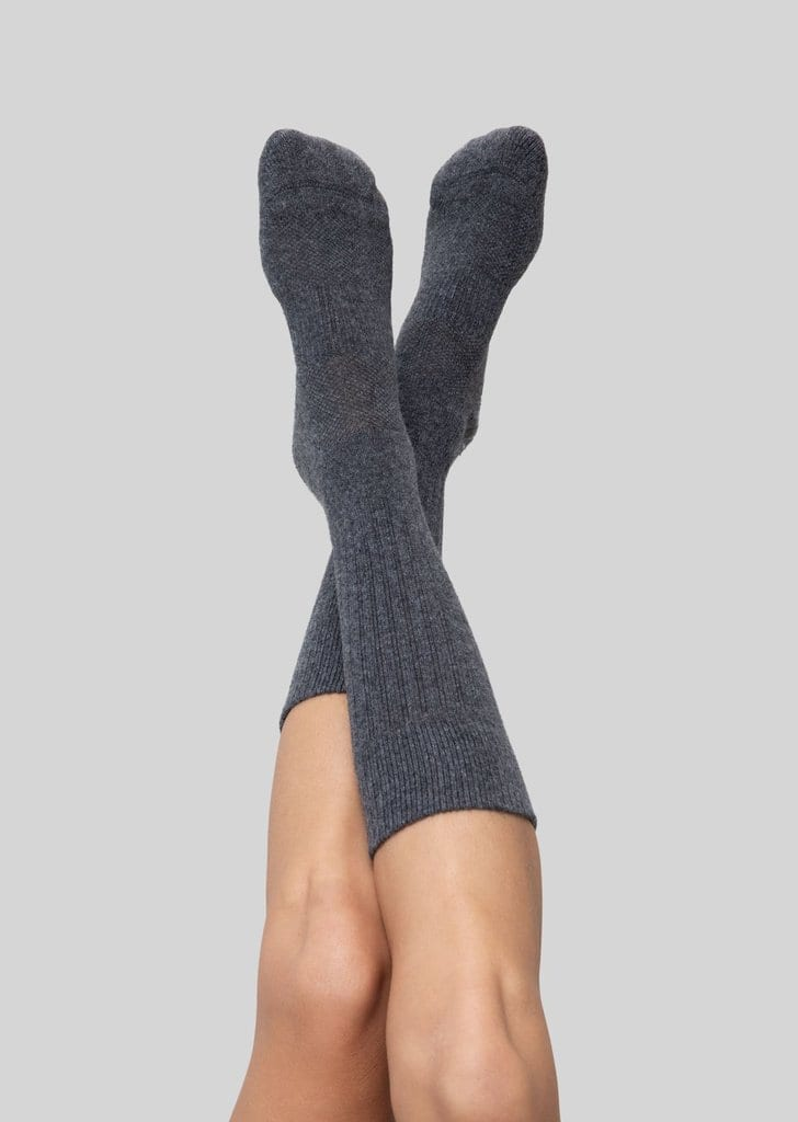 Want to create an eco-friendly laundry practice? Cut down on water use by washing your clothes less often - and invest in high-quality clothing basics. Like these anti-microbial socks by Organic Basics.
