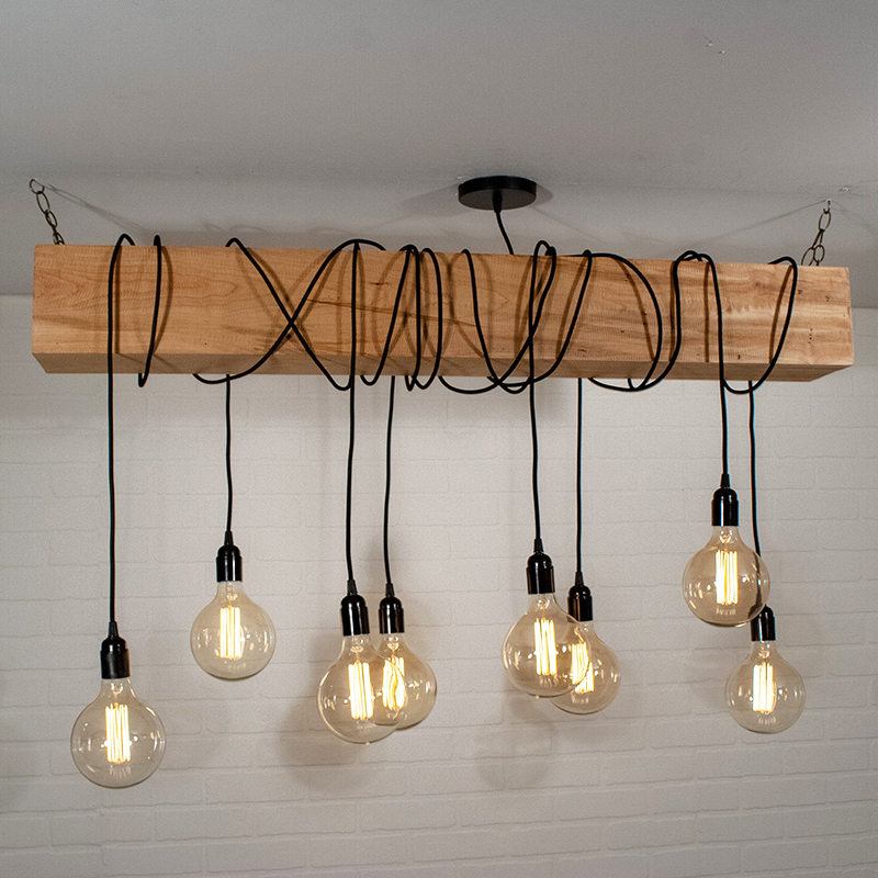 Looking for modern farmhouse light fixtures? Well, these five beauties are the real deal as they were all handmade! Like this wooden beam chandelier by LoewenDesignStudios.