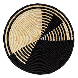 Whether your decor style is Boho, Coastal - even Minimalist - there's a set of woven basket wall decor out there with your name on it! And you can start with the Black Geo Roulette Bowl from ethical brand KAZI.
