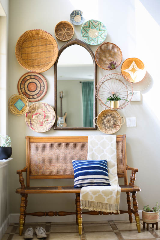 This basket wall by Lisa Leonard is a perfect example of how to use woven basket wall decor in a boho-styled home.